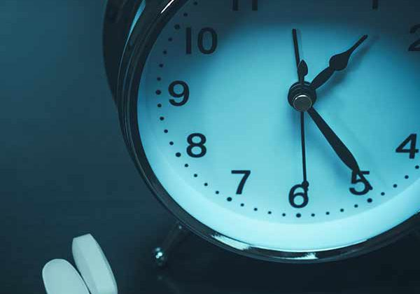 clock with sleeping pill