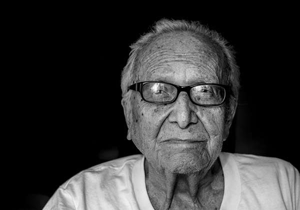 elderly man with glasses